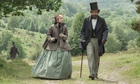 scnee from The Invisible Woman with Ralph Fiennes in a top hat walking with Felicity Jones