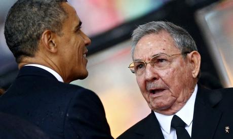 Obama greets Raul Castro at the Nelson Mandeal memorial