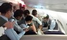 Boris Johnson tries to calm disruptive passenger