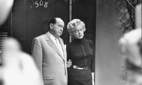 Marilyn Monroe with her lawyer Jerry Giesler following her divorce from Joe DiMaggio
