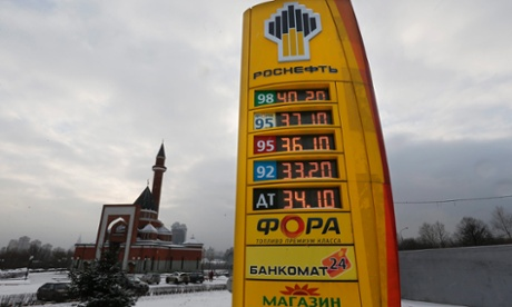 A Rosneft board displays diesel and petrol prices at a petrol station in Moscow. Oil prices tumbled to a five-year low on Monday.