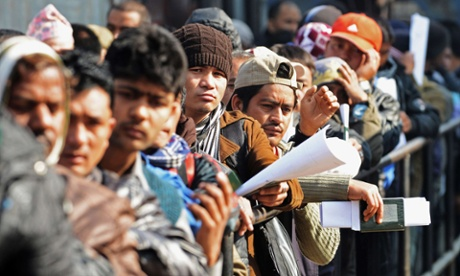 Nepalese migrant workers queue to receive official documents in order to leave Nepal from the labour department in Kathmandu.