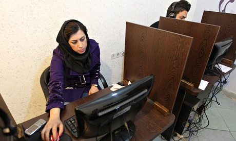 Iranians surf the internet at a cybercafe in central Tehran