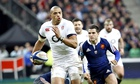 England centre Luther Burrell charges away from France defenders to score a try at Stade de France