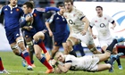 Brice Dulin of France tries to escape the attentions of England's Mike Brown in the Six Nations