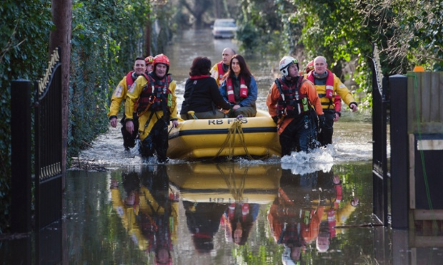 Members of the Royal Berkshire Fire Service rescue residents whose houses have been flooded in Staines-upon-Thames.