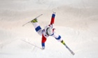 Sergey Volkov of Russia loses control of his jump in the Men's Moguls Qualification on day three of the Sochi 2014 Winter Olympic.