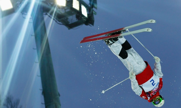 Canada's Mikael Kingsbury performs a jump during the men's freestyle skiing moguls qualification round at the 2014 Sochi Winter Olympic Games.