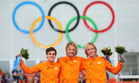 Silver medalist Jan Smeekens, gold medallist Michel Mulder and bronze medalist Ronald Mulder during the flower ceremony for the Men's 500m Speed Skating.