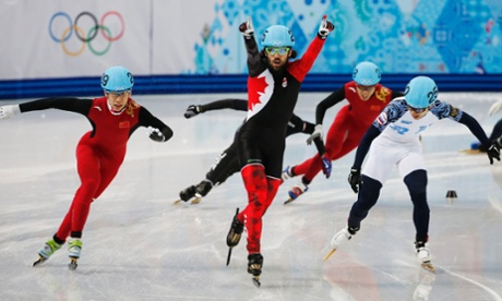 Charles Hamelin of Canada celebrates winning gold in the men's 1500m short track skating at the 2014 Winter Olympics.