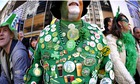 A parade goer displays his button collec