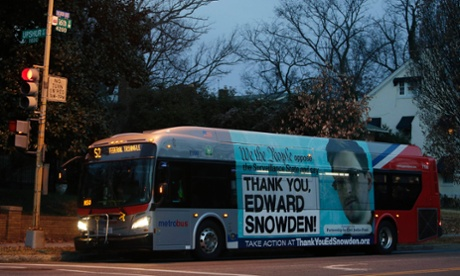 A Washington Metro bus with an Edward Snowden sign on its side panel.