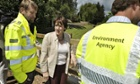 Environment secretary Caroline Spelman views flood defences Ottery St Mary, Devon
