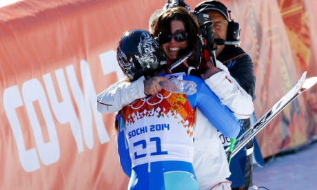 Slovenia's Tina Maze (front) hugs Switzerland's Dominique Gisin after they took joint first in the women's alpine skiing downhill race