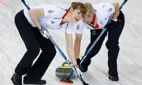 Great Britain's Claire Hamilton, left, and Anna Sloan sweep ahead of the rock during women's curling competition