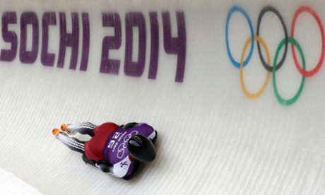 Tomass Dukurs of Latvia speeds down the track during the men's skeleton training at the 2014 Winter Olympics