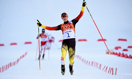 Eric Frenzel of Germany celebrates as he wins the gold medal during the Nordic Combined Individual Gundersen Normal Hill and 10km Cross Country on day five of the Sochi 2014 Winter Olympics