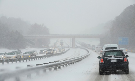 snow turns to ice in North Carolina on Wednesday. Photograph: Sara D