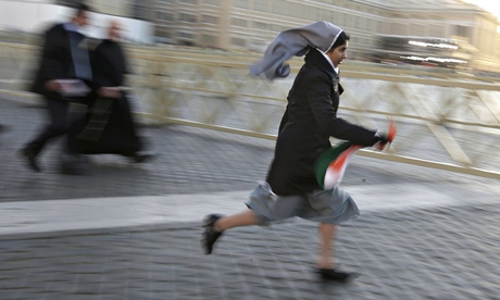 Nun on the run: a sister sprints to a good vantage point in Saint Peter's Square before the inaugural mass for Pope Francis at the Vatican in May 2013. Photograph: Max Rossi/Reuters