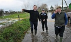 Britain's Prime Minister David Cameron (L) with Bridgwater and West Somerset  MP Ian Liddell-Grainger (R) during a visit to flood affected areas.