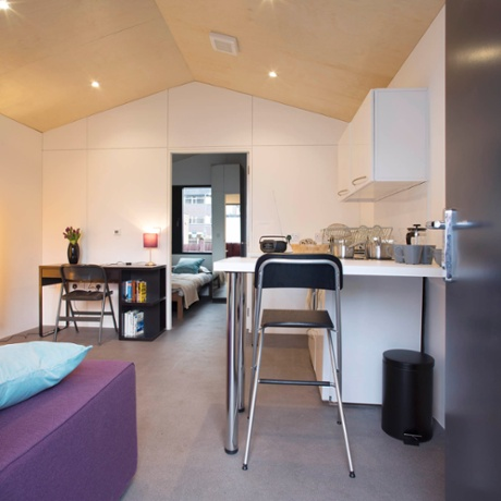 Richard rogers and ymca unveil 30k flatpack homes for for Separate kitchen units