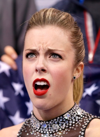 Ashley Wagner of the United States reacts to her score after competing in the ladies team figure skating short program.
