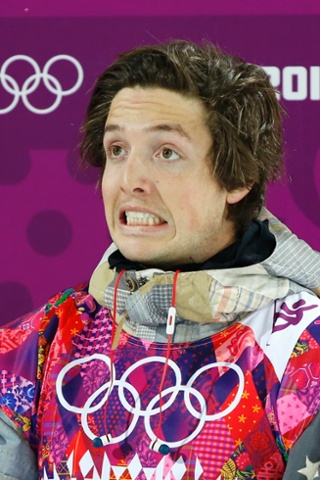 Gregory Bretz of the U.S. reacts on the finish line during the men's snowboard halfpipe semi-final.