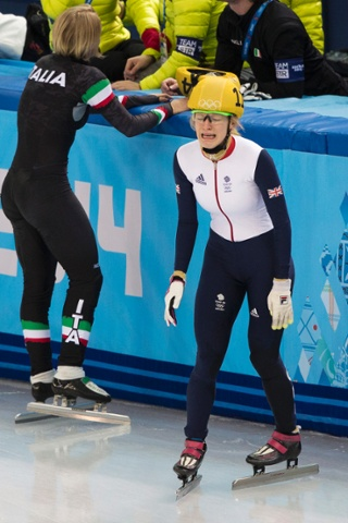 Elise Christie looks distraught after being disqualified in the final of the women's 500m short-track speed skating competition, in which she had crossed the line second.