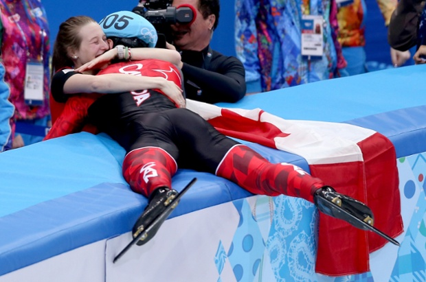 Charles Hamelin of Canada celebrates with Marianne St-Gelais after winning the men's short track 1500m final.