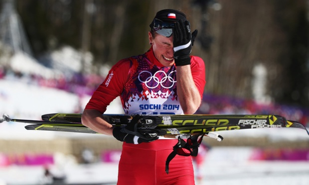 Justyna Kowalczyk of Poland reacts after crossing the finish line during the ladies' 10km Classic Cross-Country.
