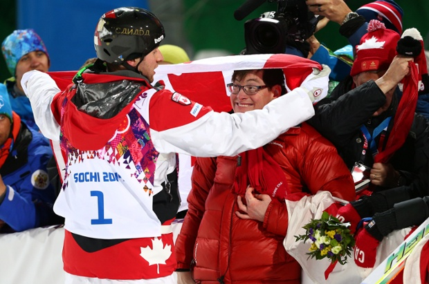 Gold medalist Alex Bilodeau of Canada celebrates with his brother Frederic after the flower ceremony for the men's moguls.