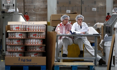 Two Chobani workers at the sleeving plant in South Edmeston, New York.