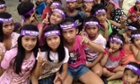Children mark the One Billion Rising day of action against violence against women in Tondo, Manila, the Philippines.