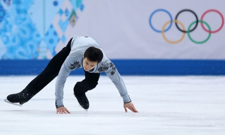 Patrick Chan of Canada falls as he competes during the men's free skating in Sochi.