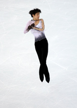 Yuzuru Hanyu of Japan spins through the air in the final of the men's free figure skating at Sochi.