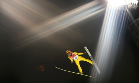 Japan's Noriaki Kasai soars through the air during the first round of the men's ski jumping large hill. The 40-year-old sits in second place going into the final jump.