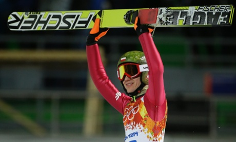 Poland's Kamil Stoch celebrates winning the gold during the ski jumping large hill final.