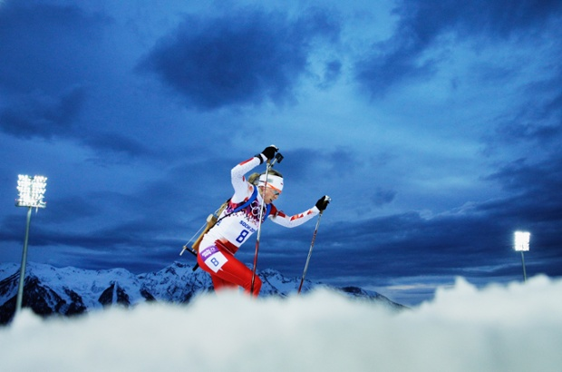 The sky turns electric blue as the sun disappears and night-time sets in, while Krystyna Palka of Poland competes in the women's 7.5 km sprint.