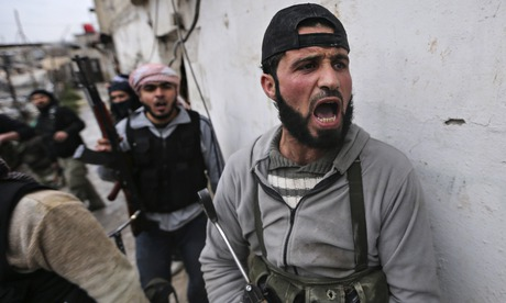 A Syrian rebel shouts before the group attacks an army checkpoint in Damascus