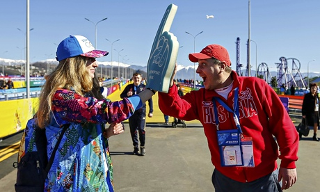 Volunteer Yuliya Udalykh is greeted by a fan at the Olympic Park in Sochi