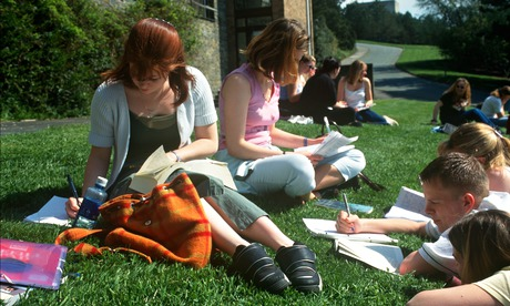 teenagers studying on lawn