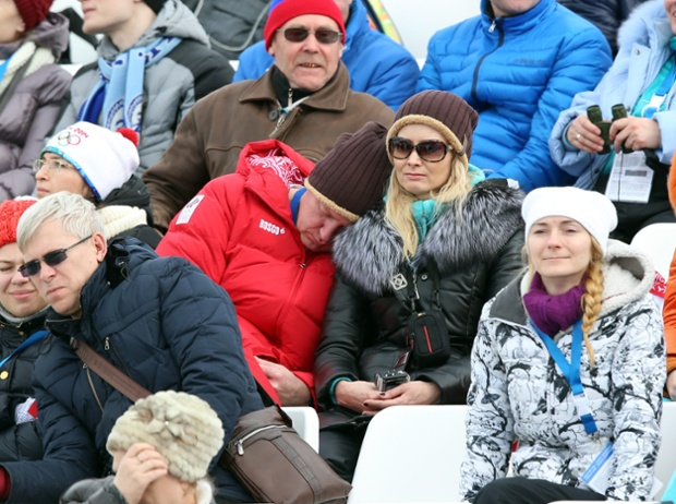 A spectator takes a nap after the semi final runs in the Women's Snowboard Slopestyle at Rosa Khutor Extreme Park