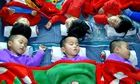 Triplets sleep at a government-run home in Wonsan city, Kangwon province, North Korea