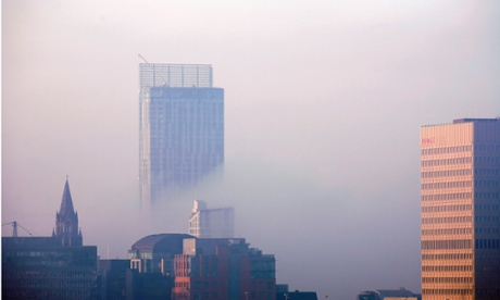 EBeetham Tower peeping out of the dawn mist on the Manchester city centre skyline.