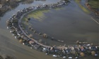 Flood water surrounds houses near Walton-on-Thames, Surrey