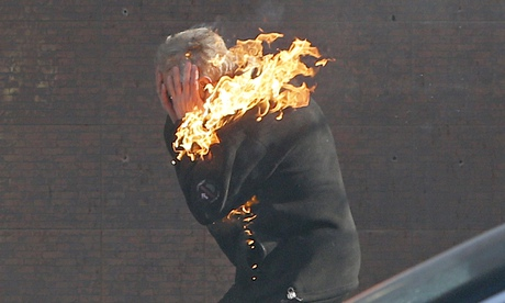 An anti-government protester is engulfed in flames