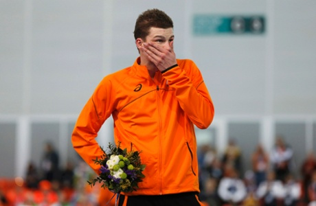 Second-placed Sven Kramer of the Netherlands on the podium during the flower ceremony for the men's 10,000metres speed skating.