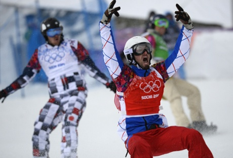 France's Pierre Vaultier celebrates his gold medal, ahead of Russia's Nikolay Olyunin and the USA's Alex Deibold, in the men's snowboard cross at the Sochi Winter Olympics.