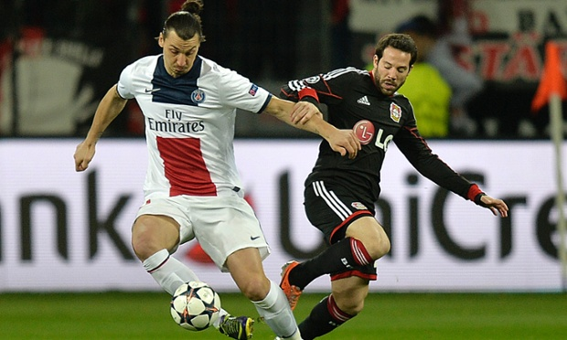 PSG's Zlatan Ibrahimovic, left, steps away from Bayer Leverkusen's Gonzalo Castro.
