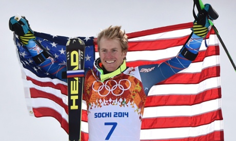 Gold medalist Ted Ligety of the USA  celebrates during the flower ceremony for the men's giant slalom race at Sochi.